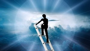 man climbing ladder to the clouds